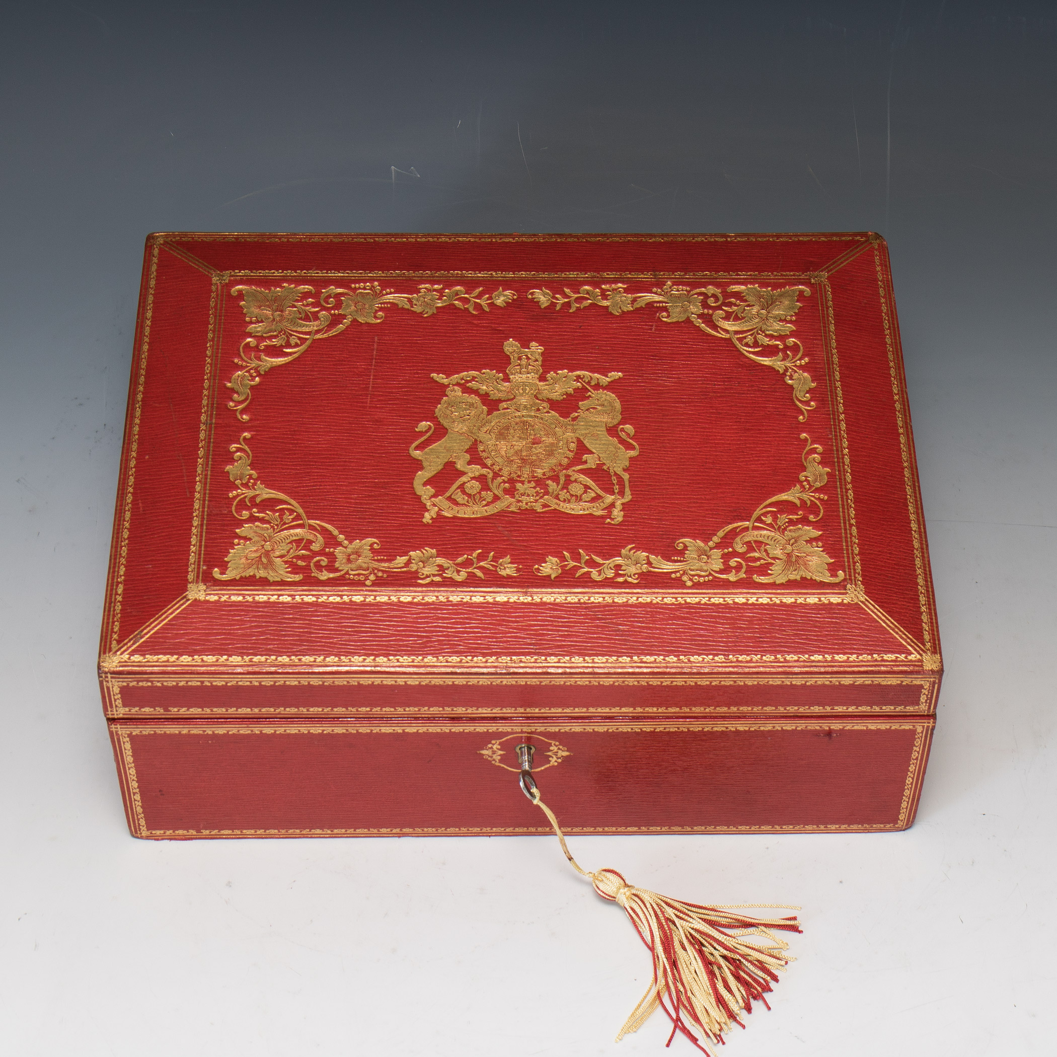 A George V Red Leather Box With Royal Warrant On Vellum